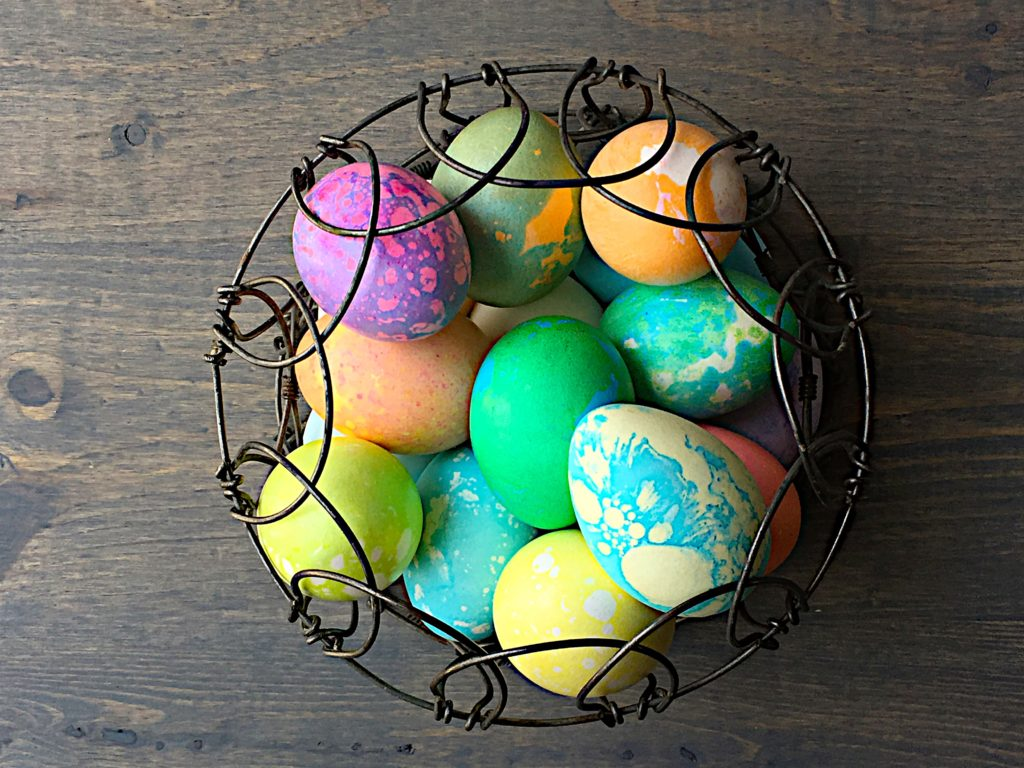 Colored eggs in basket 1
