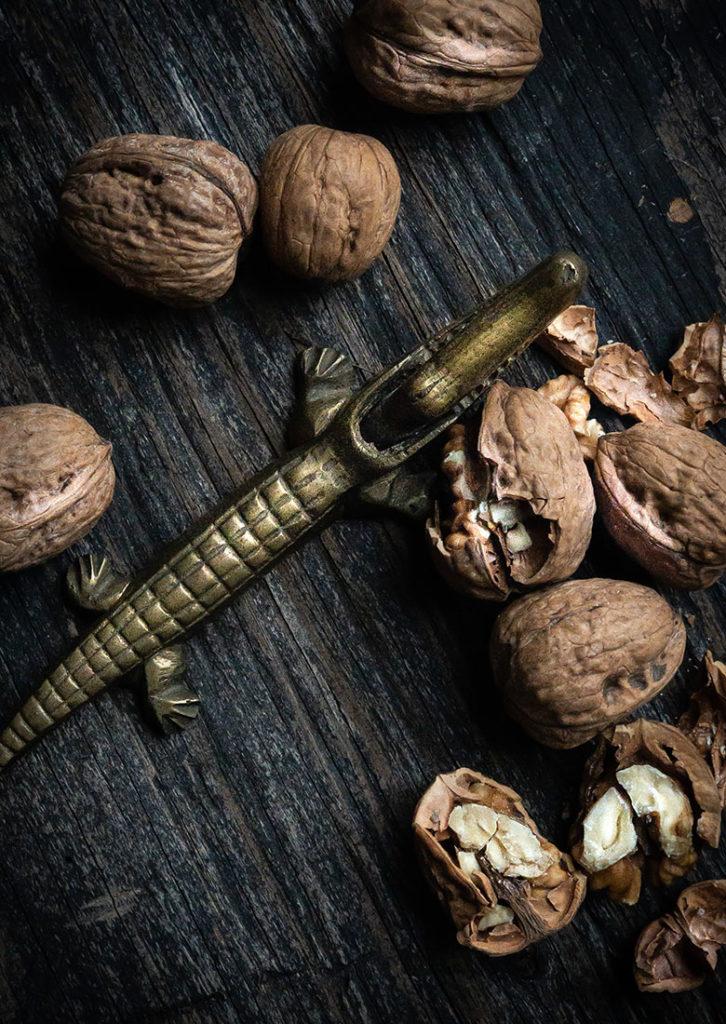 English walnuts with brass alligator nutcraker